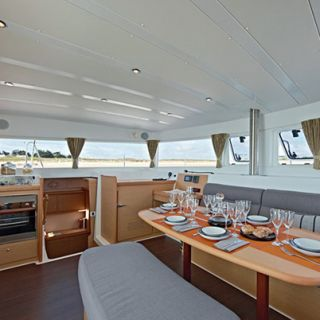 The main saloon on a Lagoon 52 with table set for guests