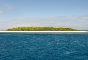 Sailing past one of the many islets off New Caledonia's southern coast