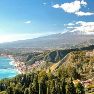 Taormina with brooding Etna behind